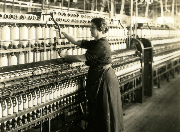 Woman at spinning machine